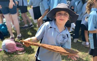 St Kevin's Catholic Primary School Eastwood - student holding a bat